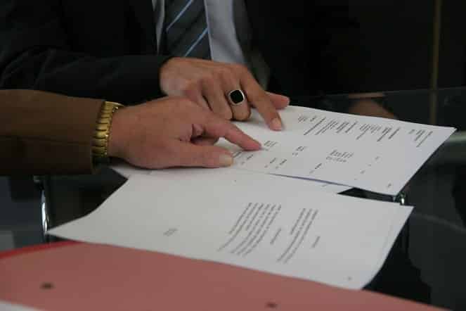 businessman reading contract papers closeup