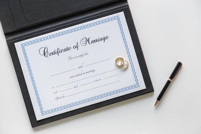 certificate of marriage and a pen on white table in court Florida USA