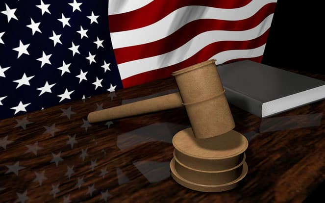 a flag of USA and a judicial gavel
