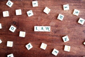 the word law written on cubes on wooden table